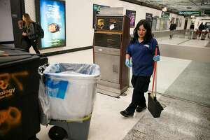 The BART custodian, Lucy Villanueva, cleans around the Powell Street BART station in San Francisco, Calif. Thursday, July 13, 2017.