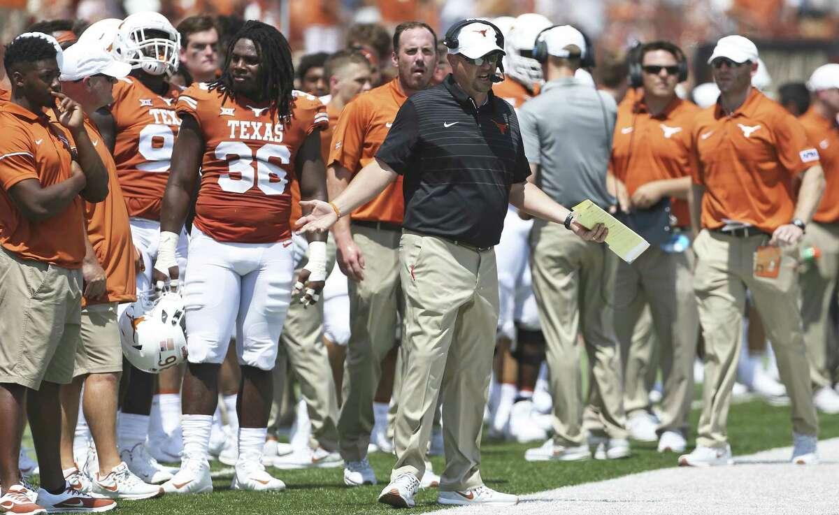 Coach Tom Herman tries to figure out plays as Texas plays Maryland at DKR Stadium on September 2, 2017.