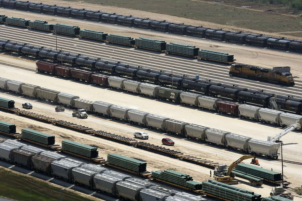 Rail cars load and unload at the Gardendale Railroad Inc. switching yard in LaSalle County near Cotulla, Texas, in 2012. More oil is starting to be sent from West Texas to the Gulf Coast by truck and rail as pipelines out of the Permian Basin are full of crude.