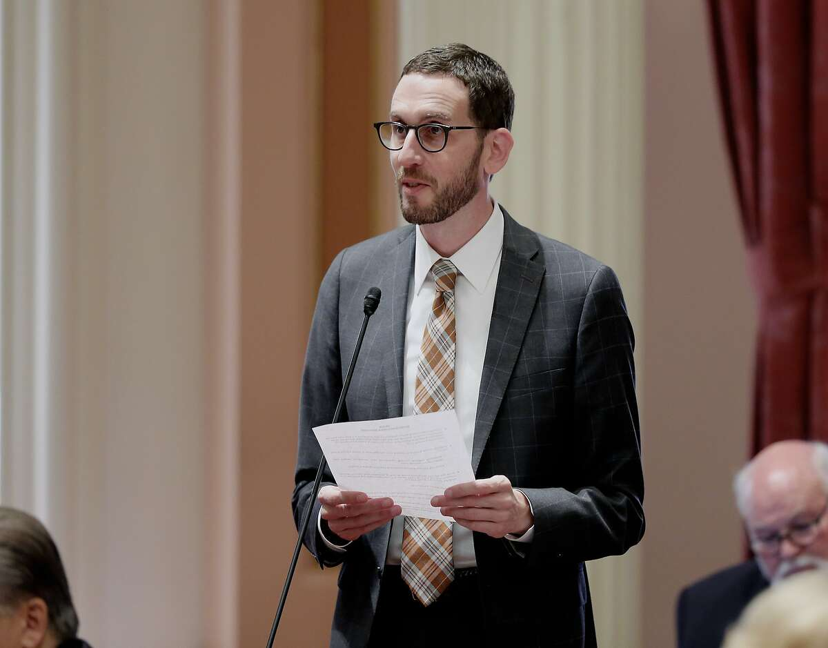 State Sen. Scott Wiener, D-San Francisco, addresses the state Senate, Thursday, Aug. 30, 2018, in Sacramento, Calif. The Assembly approved Wiener's net neutrality bill seeking to revive regulations repealed last year by the Federal Communications Commission that prevented internet companies from exercising more control over what people watch and see on the internet. (AP Photo/Rich Pedroncelli)