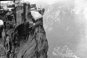 Tourists still venture out on this perilous ledge at Yosemite.    Undated/Photographer: unknown     Yosemite National Park Photo Collection