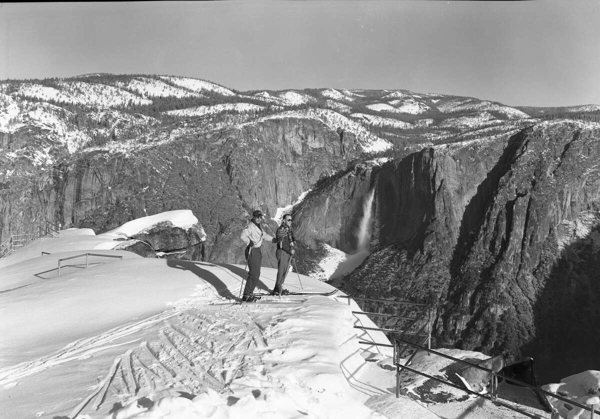 Ed Beatty and George Goldworthy come close to skiing off the edge of Glacier Point in the winter of '42. March 1942/ Photographer: Ralph H. Anderson Yosemite National Park Photo Collection
