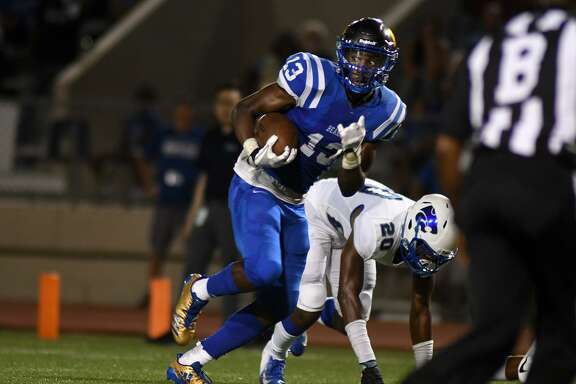 Klein senior wide receiver James Preston (13) heads for the end zone after finishing a catch against Cy Creek senior defensive back Arzeviur Richardson (20) on a touchdown play late in the second quarter of their football season opener at Klein Memorial Stadium on August 30, 2018.