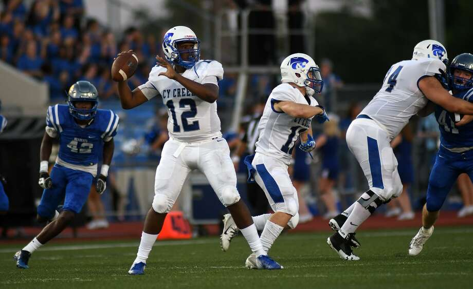 Cy Creek senior quarterback Julian Brown (12) led the Cougars to victory over Katy Taylor, 24-14, with 313 passing yards and three touchdowns, Nov. 23, at Rhodes Stadium in the Area round. Photo: Jerry Baker, Houston Chronicle / Contributor / Houston Chronicle