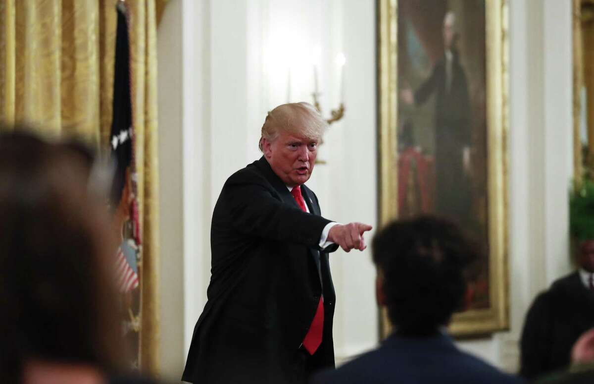 President Donald Trump gestures while speaking during an event to salute U.S. Immigration and Customs Enforcement (ICE) officers and U.S. Customs and Border Protection (CBP) agents in the East Room of the White House in Washington, Monday, Aug. 20, 2018.