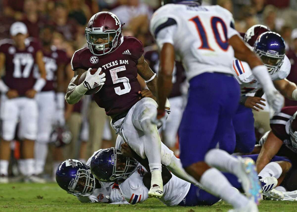 Texas A&M Aggies running back Trayveon Williams (5) rushes the ball against the Northwestern State defense during the second quarter of the NCAA game at KyleFieldThursday, Aug. 30, 2018, in College Station, Texas.