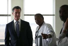 SAN FRANCISCO, CA - AUGUST 22:  California Lt. Gov. and California gubernatorial candidate Gavin Newsom (L) talks with residents as he visits the Alice Griffith Apartments on August 22, 2018 in San Francisco, California. Lt. Gov. Gavin Newsom and San Francisco mayor London Breed toured a low-income housing complex. Newsom leads Republican gubernatorial candidate John Cox by an average of 23 percentage points in recent polls.  (Photo by Justin Sullivan/Getty Images)