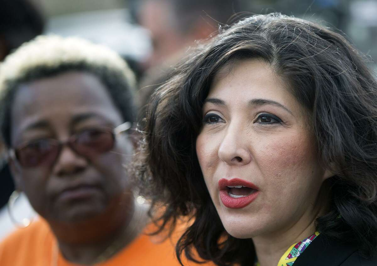 In this 2015 file photo, Juliet Stipeche, right, speaks during a news conference addressing concerns regarding a wreck involving a school bus that killed two HISD students. (Cody Duty / Houston Chronicle)