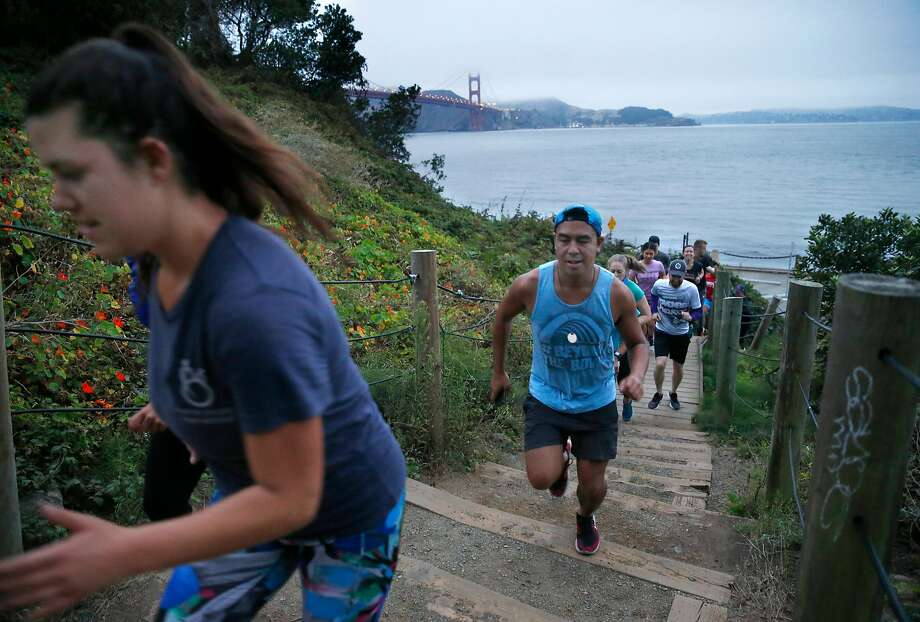 Participants sprint up a staircase in the November Project fitness work out at the Presidio in San Francisco, No. 6 among healthy counties. in August 2018. Photo: Paul Chinn / The Chronicle 2018