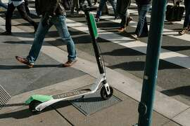 FILE -- A scooter on the sidewalk in downtown San Francisco, April 16, 2018. Doctors and public health workers in San Francisco are preparing to track injuries from electric scooters and the other transportation services blossoming in the city. (Jason Henry/The New York Times)