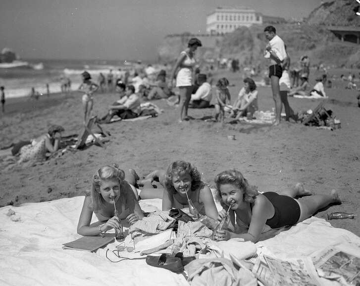 A warm 1943 day .. at Ocean Beach and bathers are enjoying the beach.