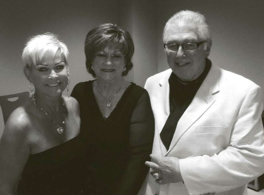 Gene and Betty Wolf (shown here with Lorrie Morgan) celebrated their 37 wedding anniversary with a visit to Kerrville where they attended the Lorrie Morgan Show and met with the star on August 24. Sharity Productions, owned by the Wolfs, brought Morgan to Conroe's Crighton Theatre a few seasons ago. Her most recent performance here was presented by the Friends of Downtown Conroe Association on August 25, also in the Crighton Theatre.