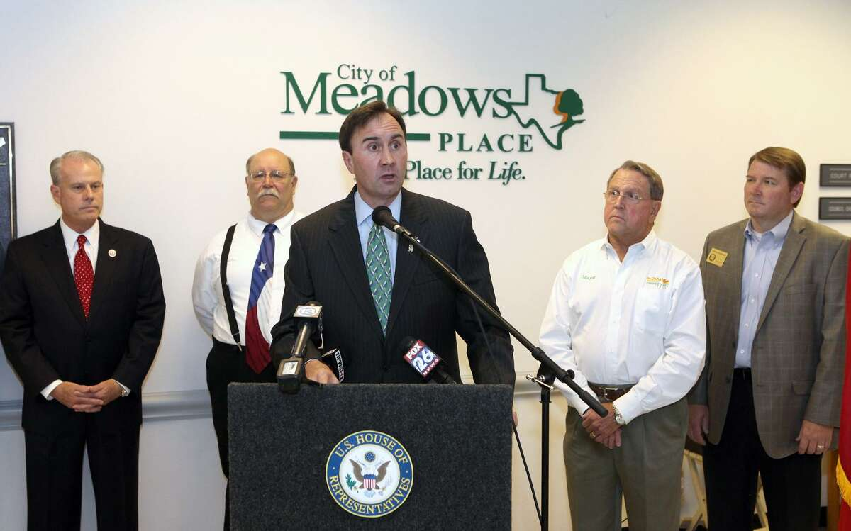 Congressman Pete Olson speaks along with local mayors to announce legislation to give state and local communities a voice in where Central American unaccompanied alien children crossing into Texas through Mexico will be located during a news conference at Meadows Place City Hall in Meadows Place, Texas on Friday, July 18, 2014. (AP Photo/Conroe Courier, Alan Warren)