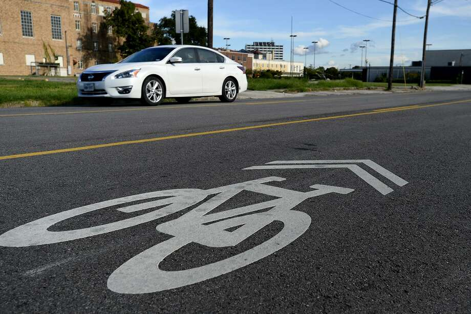 "A shared lane marking, known as a ""sharrow,"" on Magnolia Street in downtown Beaumont. The South East Texas Regional Planning Commission's ""Hike and Bike Plan 2037 has recommendations on how cities can improve infrastructure for pedestrians and bicyclists as alternative transportation. Photo: Ryan Pelham / The Enterprise / ©2018 The Beaumont Enterprise"