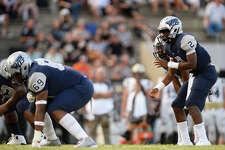 West Orange-Stark quarterback Tyrone Wilson takes the snap against Nederland at Dan R. Hooks Stadium. Photo taken Friday 8/31/18 Ryan Pelham/The Enterprise