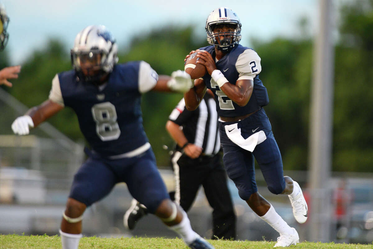 West Orange-Stark quarterback Tyrone Wilson looks to throw against Nederland at Dan R. Hooks Stadium. Click for more photos from Week 2 football in SE Texas.