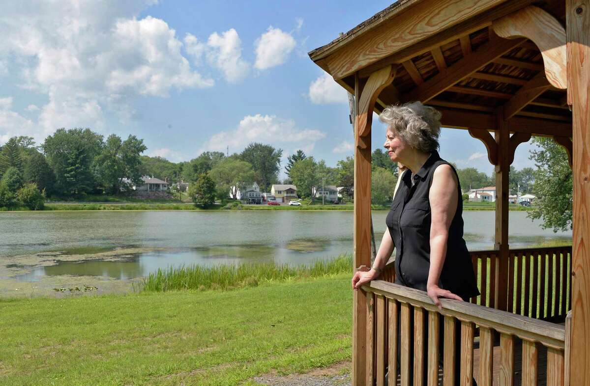 Historian BobbieReno looks out on Hampton Lake and the Hampton Manor development on its shores Wednesday August 29, 2018 in East Greenbush, NY. (John Carl D'Annibale/Times Union)