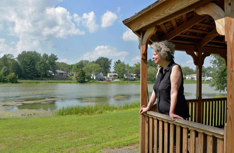 Historian Bobbie Reno looks out on Hampton Lake and the Hampton Manor development on its shores Wednesday August 29, 2018 in East Greenbush, NY.  (John Carl D'Annibale/Times Union) Photo: John Carl D'Annibale, Albany Times Union / 20044678A