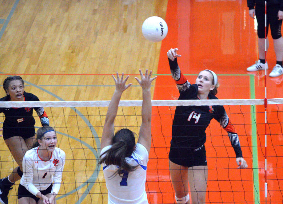 Edwardsville junior Maddie Isringhausen, right, goes for a kill during Friday's season-opening match against Columbia at the Tiger Classic. Photo: Scott Marion