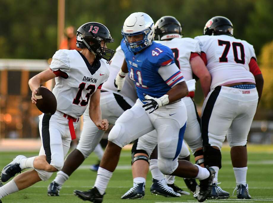 Oak Ridge senior defensive lineman Darius Richmond (41) pressures Pearland Dawson senior quarterback Patrick Kramer (13) in the first quarter of their season opener at Woodforest Bank Stadium in Shenandoah on Friday. Photo: Jerry Baker, Houston Chronicle / Contributor / Houston Chronicle
