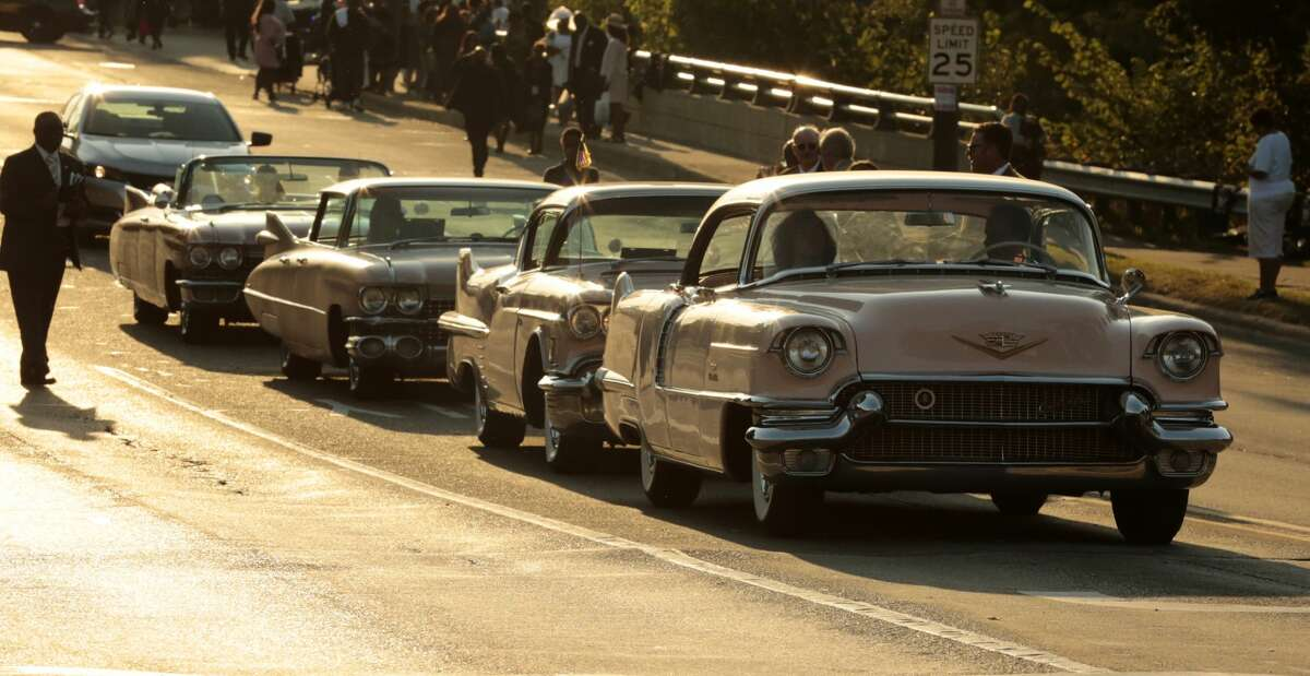 Pink Cadillacs line Seven Mile Road outside Aretha Franklin's funeral at the Greater Grace Temple in on August 31, 2018 in Detroit, Michigan. (Photo by JEFF KOWALSKY / AFP) (Photo credit should read JEFF KOWALSKY/AFP/Getty Images)
