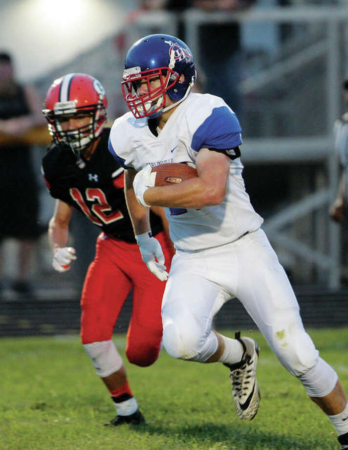 Carlinville's Jake Ambuel turns up field as he slips through the Gillespie defence for 37 yard touch down run Friday night in Gillespie. Photo: James B. Ritter | For The Telegraph
