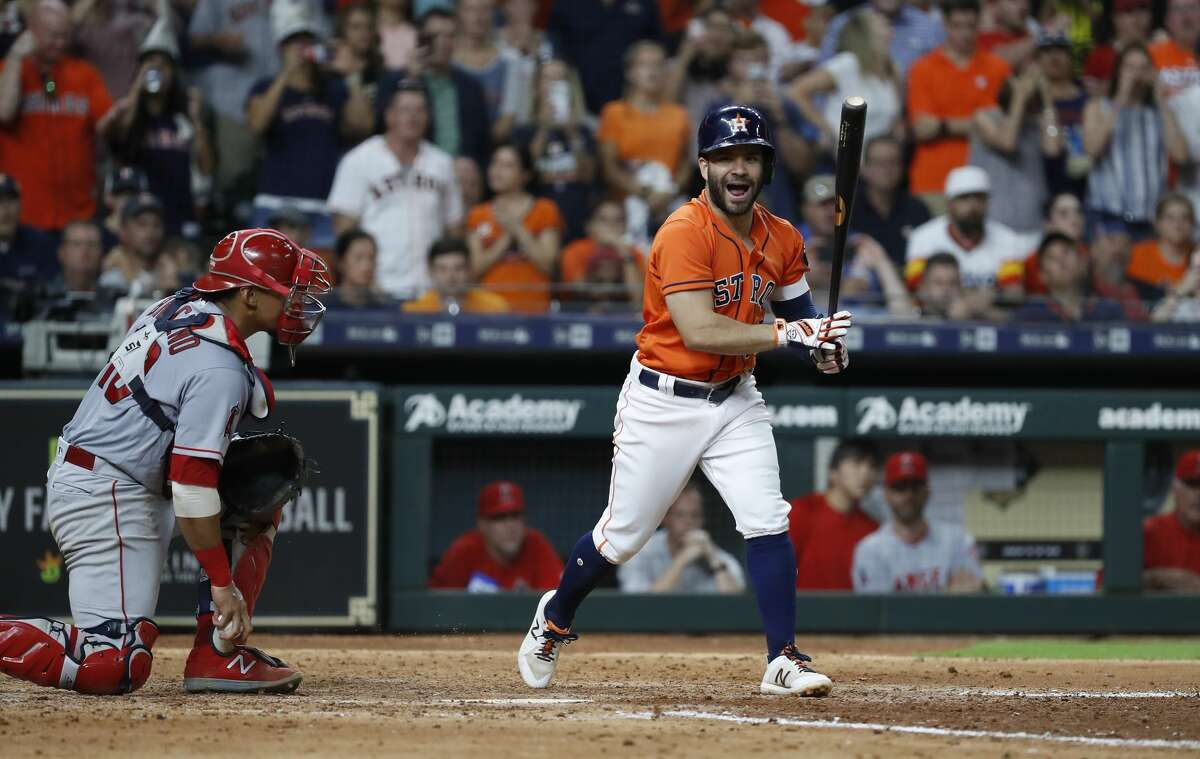Houston Astros Jose Altuve (27) reacts after being called out on strikes during the eighth inning of an MLB baseball game at Minute Maid Park, Friday, August 31, 2018, in Houston.