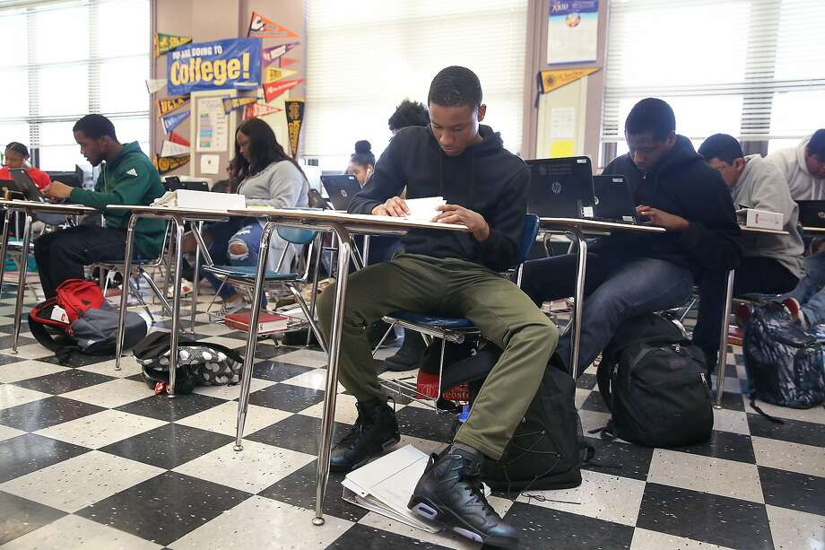 A senior english class working on their biographies at McClymonds High School on Friday, May 18, 2018 in Oakland, Calif. Photo: Liz Hafalia / The Chronicle