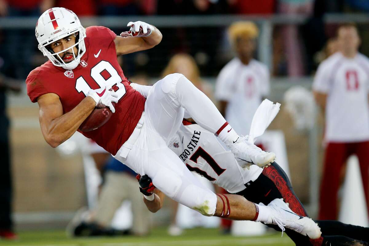 Stanford Cardinal wide receiver JJ Arcega-Whiteside (19) makes the catch for a touchdown against San Diego State Aztecs cornerback Ron Smith (17) during an NCAA football game at Stanford Stadium, Friday, Aug. 31, 2018, in Stanford, Calif.