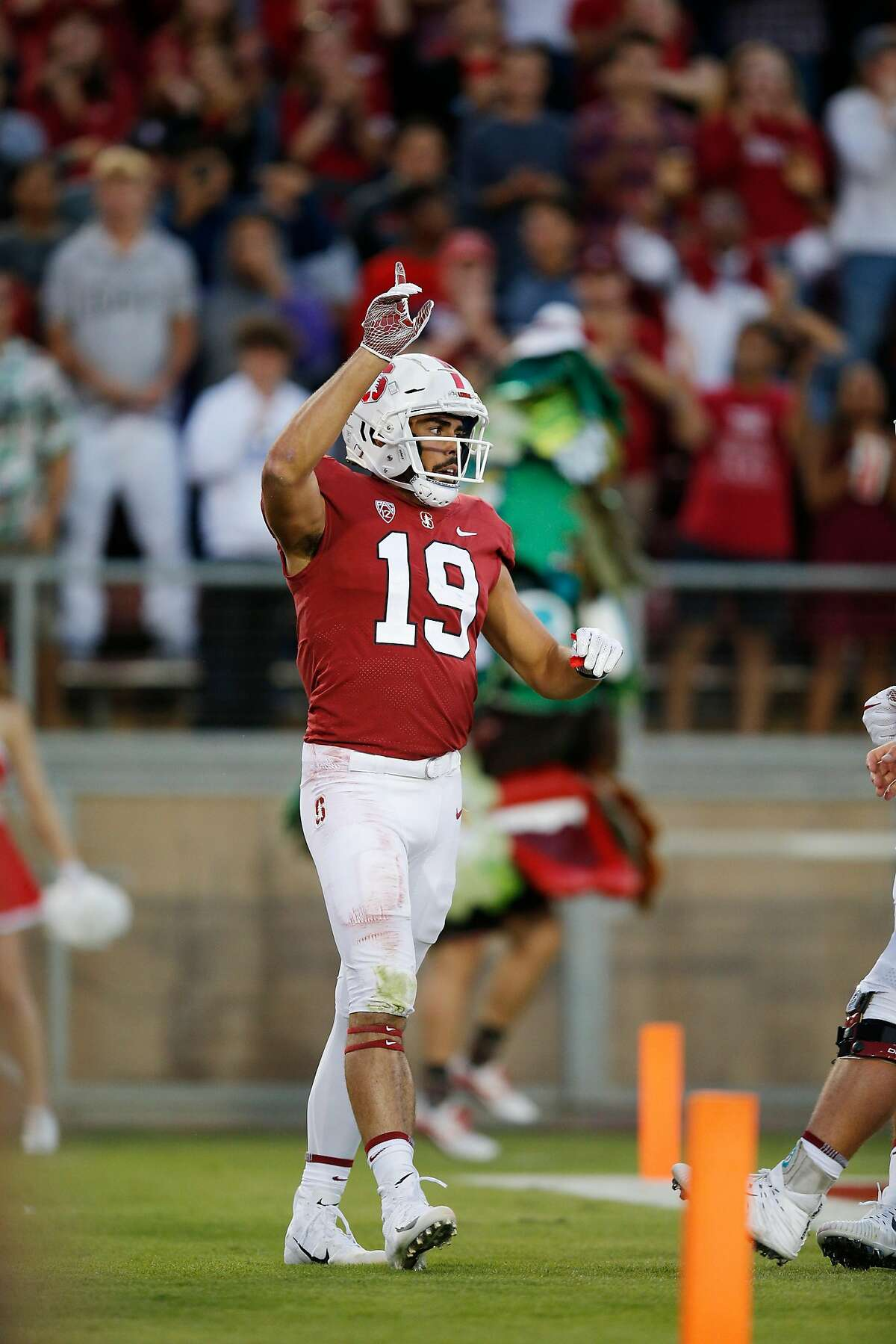 Stanford Cardinal wide receiver JJ Arcega-Whiteside (19) reacts after his touchdown catch against San Diego State Aztecs cornerback Ron Smith (17) during an NCAA football game at Stanford Stadium, Friday, Aug. 31, 2018, in Stanford, Calif.