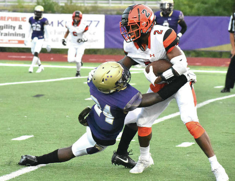 Edwardsville receiver Norman Harris breaks a tackle en route to a first-quarter touchdown against CBC on Friday in Town and Country, Mo.