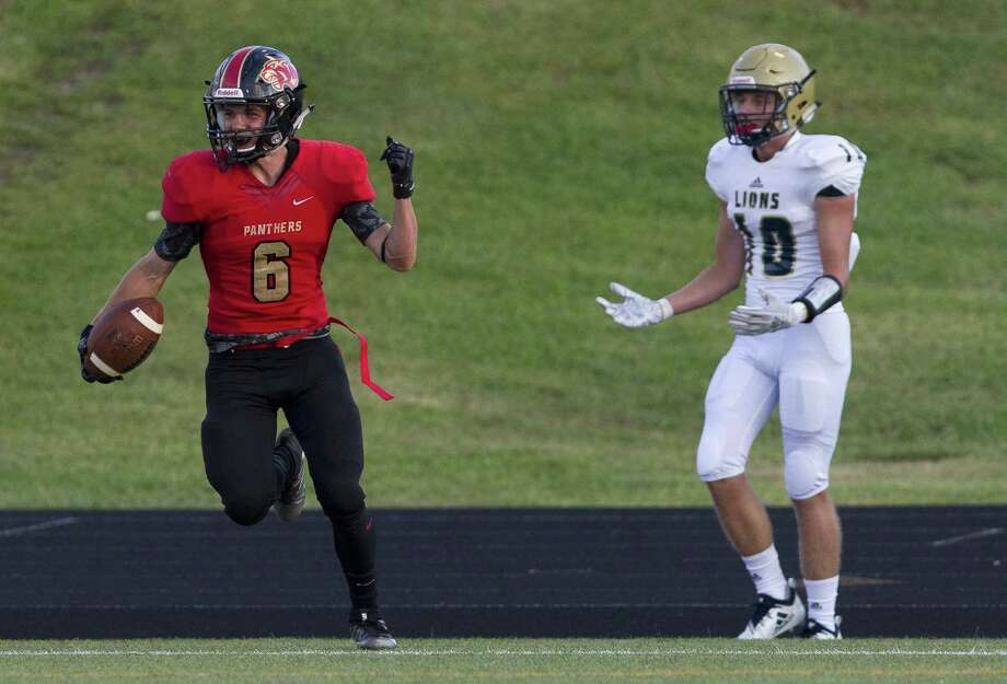 Caney Creek quarterback Cody Fay (6) reacts beside Lake Creek defensive back Zachery Hazlewood (10) after hauling in a 22-yard touchdown pass from quarterback Julian Hernandez during the first quarter of a non-district high school football game at Buddy Moorhead Stadium on Friday, Aug. 31, 2018, in Conroe. Photo: Jason Fochtman,  Staff Photographer / Houston Chronicle / © 2018 Houston Chronicle