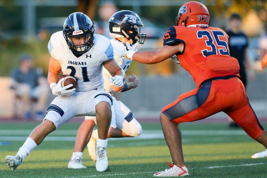 Johnson's Justin Rodriguez (left) looks for a way around Brandeis' Mark Lara during the first half of their season-opening high school football game at Farris Stadium on Friday, Aug. 31, 2018. Brandeis beat Johnson 35-17. Photo: Marvin Pfeiffer, Staff / San Antonio Express-News / Express-News 2018