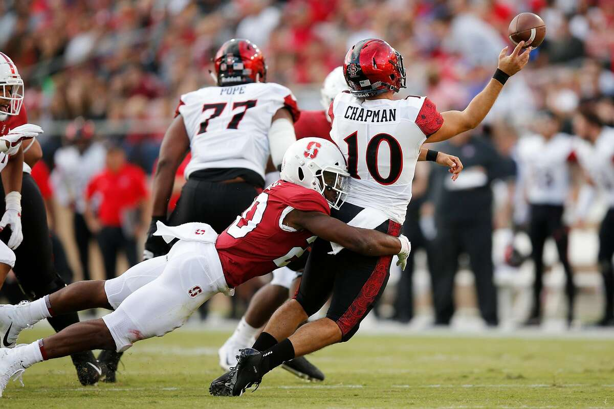 Stanford Cardinal linebacker Bobby Okereke (20) tackles San Diego State Aztecs quarterback Christian Chapman (10) as he throws an incomplete pass during an NCAA football game at Stanford Stadium, Friday, Aug. 31, 2018, in Stanford, Calif.