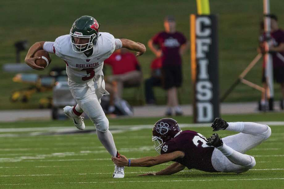 The Woodlands quarterback Casey Sunseri (3) is tripped up at the line of scrimmage by Cy-Fair defensive back Marcus McKinley (28) in the second quarter of a high school football game at Pridgeon Stadium on Friday, Aug 31, 2018, in Houston. Photo: Joe Buvid, Contributor / Houston Chronicle / © 2018 Joe Buvid