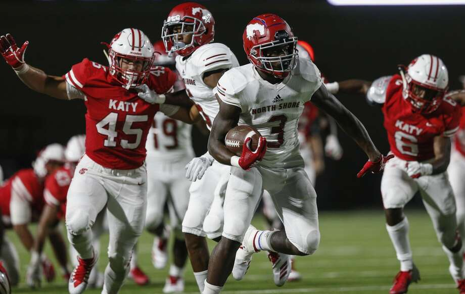 North Shore Mustangs running back Zachary Evans (3) runs the ball pursued by Katy Tigers middle linebacker Garrett Madison (45) during the high school football game between the North Shore Mustangs and the Katy Tigers at Legacy Stadium in Houston, TX on Friday, August 31, 2018. Photo: Tim Warner/Contributor/Contributor