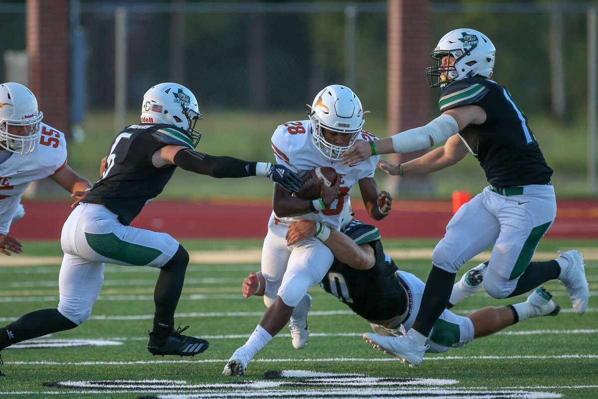August 31, 2018: Dobie Longhorns Dontavion Crosby gets tackled during the high school football game between the Dobie Longhorns and Santa Fe Indians in Santa Fe, Texas. (Leslie Plaza Johnson/For the Chronicle)