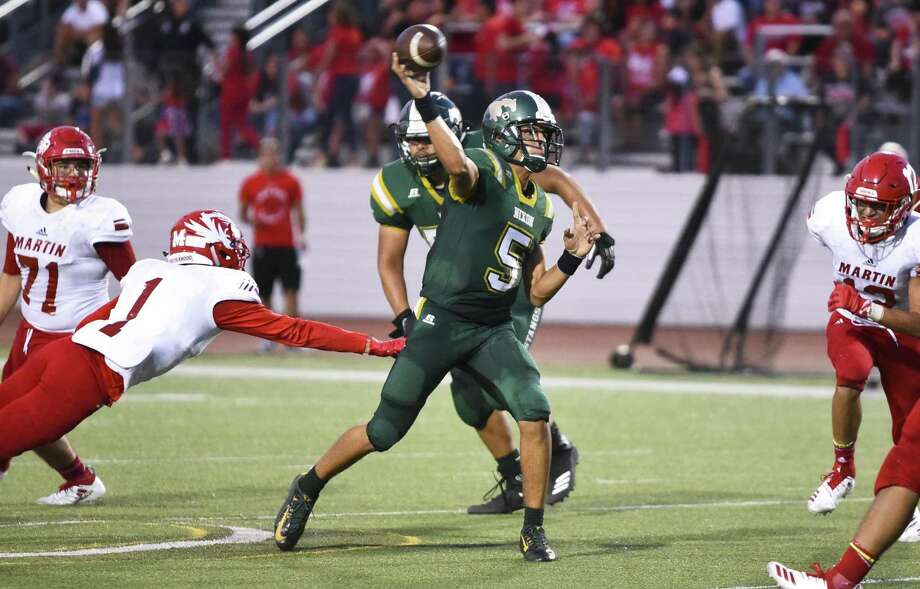 Nixon High School J.C. Ayala passes the ball during a game against Martin High School at Shirley Field on Friday, Aug. 31, 2018. Photo: Danny Zaragoza /Laredo Morning Times / Laredo Morning Times