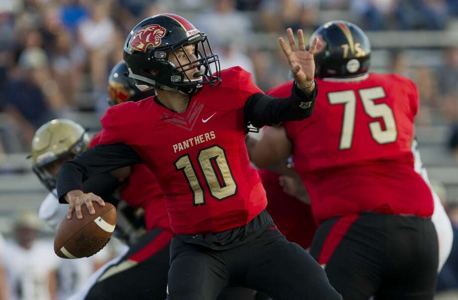 Caney Creek quarterback Julian Hernandez (10) drops back to pass during the first quarter of a non-district high school football game at Buddy Moorhead Stadium on Friday, Aug. 31, 2018, in Conroe. Photo: Jason Fochtman/Houston Chronicle