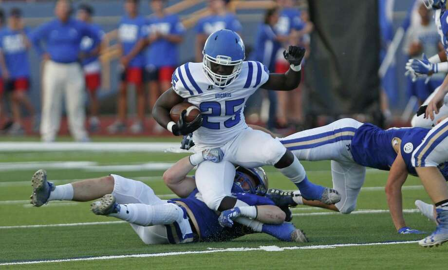 New Braunfels Piale Thomas, 25, is brought down by Alamo Heights Maki Carabin. Alamo Heights played New Braunfels at Harry B. Orem stadium on Friday, Aug., 31, 2018. Photo: Ronald Cortes, Photo Correspondent / 2018 Ronald Cortes