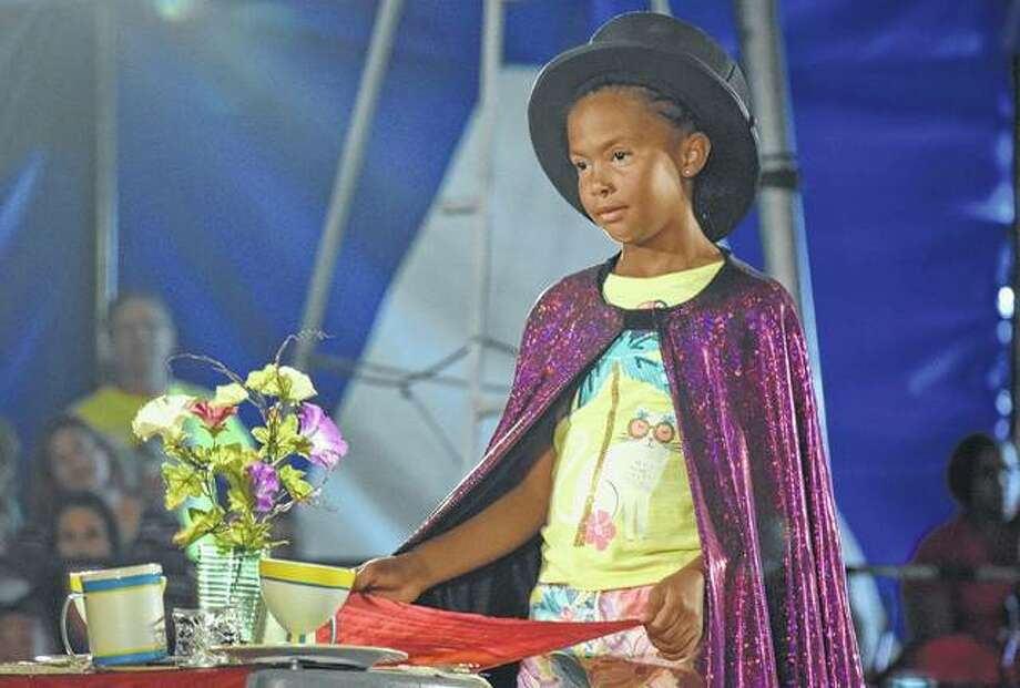 Danaesha Ratller, 9, the daughter of Denis and Amy Rattler performs a magic trick during the Culpepper and Merriweather Circus Friday at the Morgan County Fairgrounds. Photo: Samantha McDaniel-Ogletree | Journal-Courier