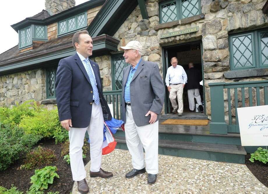 At left, Greenwich First Selectman Peter Tesei speaks with former Greenwich First Selectman, John Margenot, during the Founder's Day Celebration, commemorating the 375th anniversary of Greenwich at Innis Arden Cottage, Greenwich Point, Conn., Saturday morning, July 18, 2015. Photo: Bob Luckey Jr. / Hearst Connecticut Media / Greenwich Time