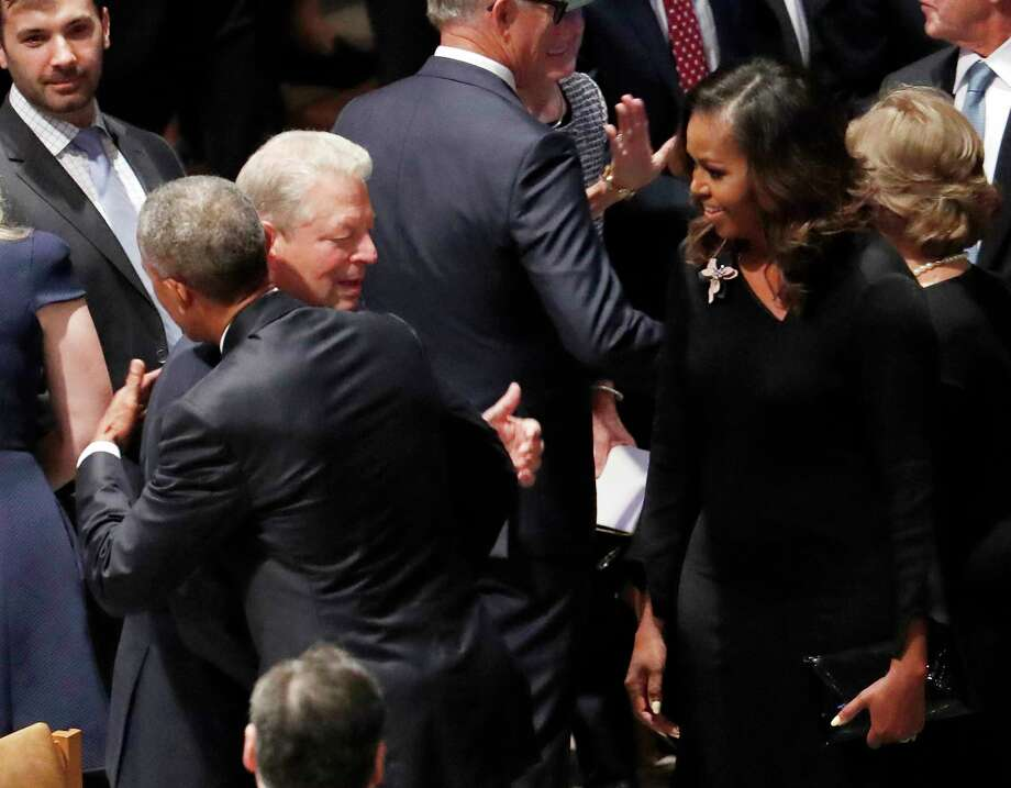 Former President Barack Obama hugs former vice president Al Gore as former first lady Michelle Obama watches before the memorial services for Sen. John McCain, R-Ariz., at Washington Nationals Cathedral in Washington, Saturday, Sept. 1, 2018. McCain died Aug. 25, from brain cancer at age 81. Photo: Pablo Martinez Monsivais, AP / Copyright 2018 The Associated Press. All rights reserved