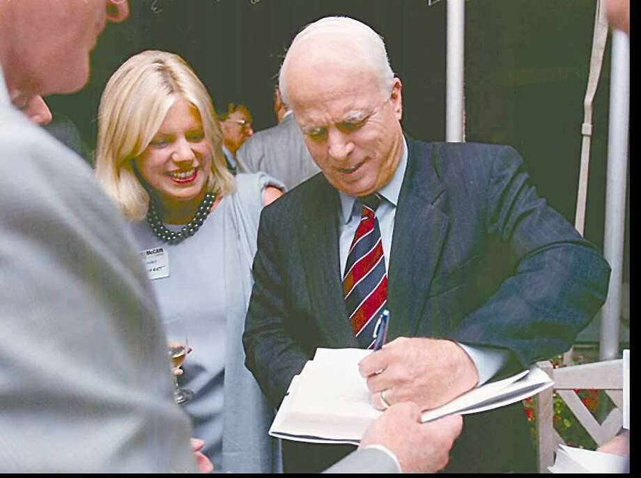 U.S. Sen. John McCain signs a copy of his book while campaigning for president in Greenwich in 1999. Photo: Staff File Photo