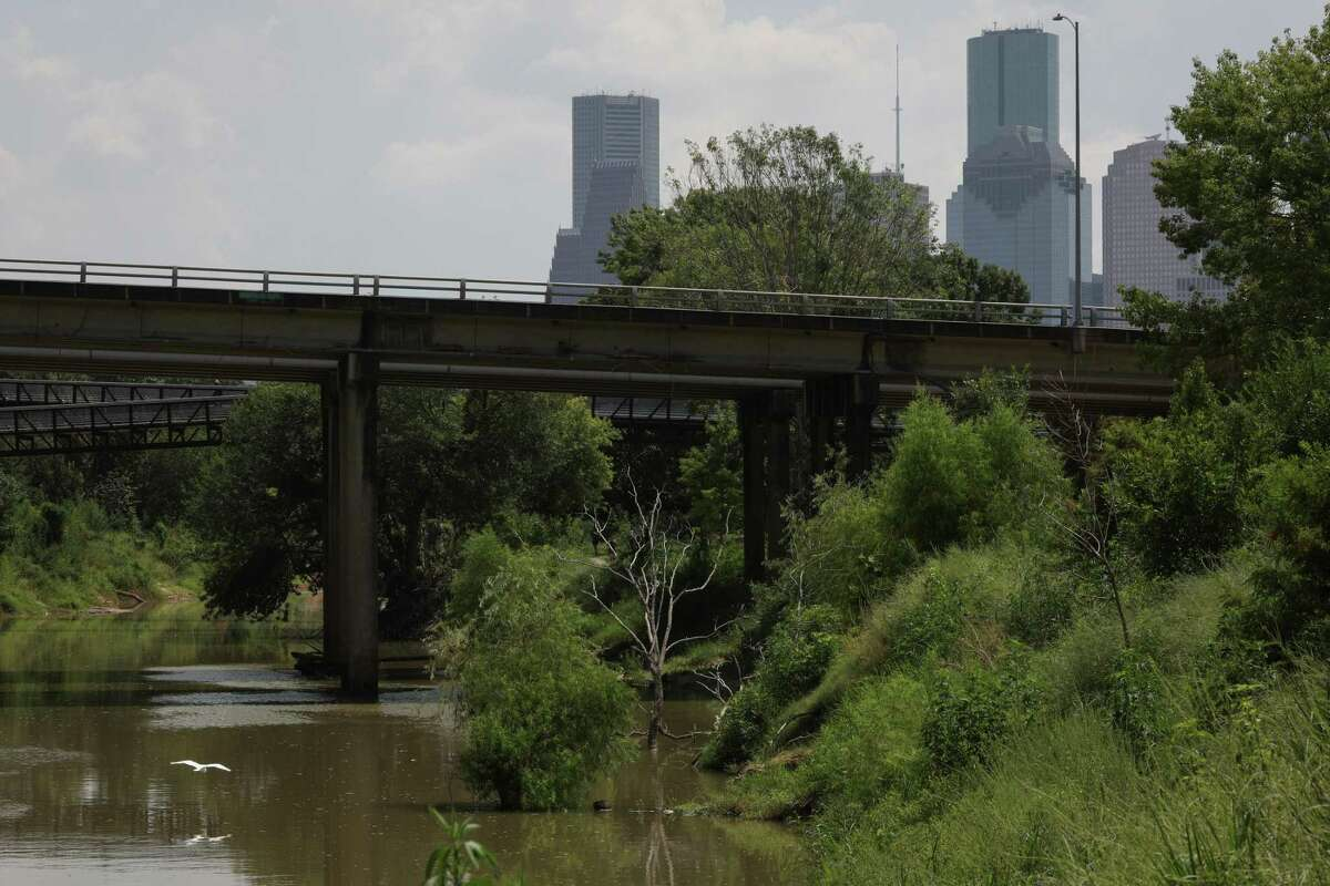 Downtown high-rises are pictured beyond Buffalo Bayou in Houston on Aug. 25, 2018.