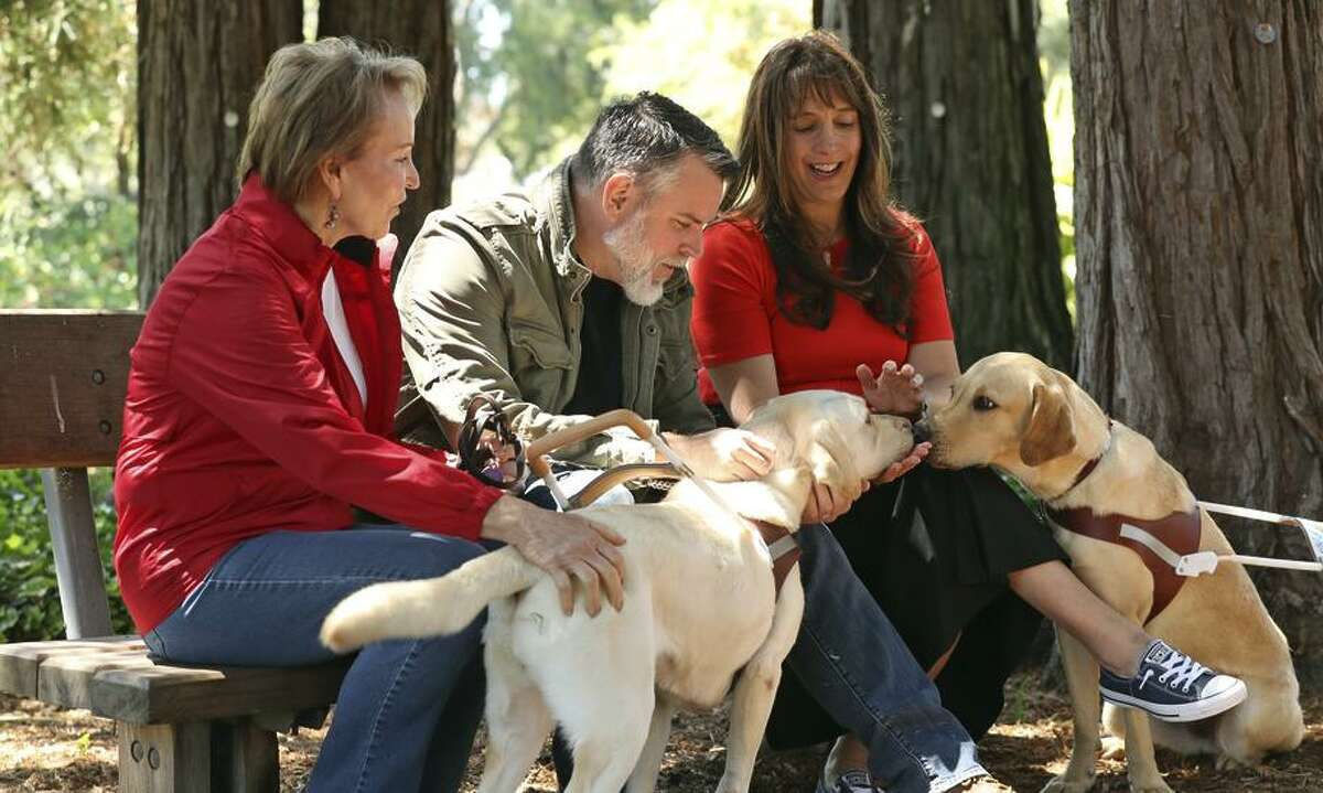 Guide Dogs for the Blind CEO Chris Benninger (left), with Moon and Julia, meets directors Don Hardy and Dana Nachman.