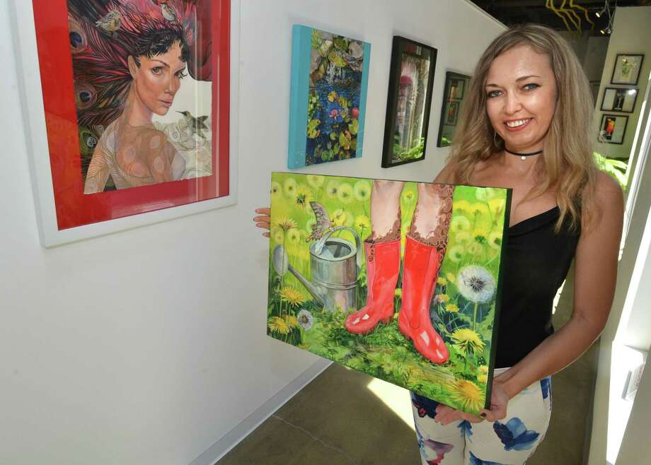 Artist Olga Klymyk stands with one of her watercolors titled Wet Feet just one of 20 included in her exhibit at The Sidewalk Gallery on Thursday August 30 2018. The show is on view until September 30th in Norwalk Conn. Photo: Alex Von Kleydorff / Hearst Connecticut Media / Norwalk Hour
