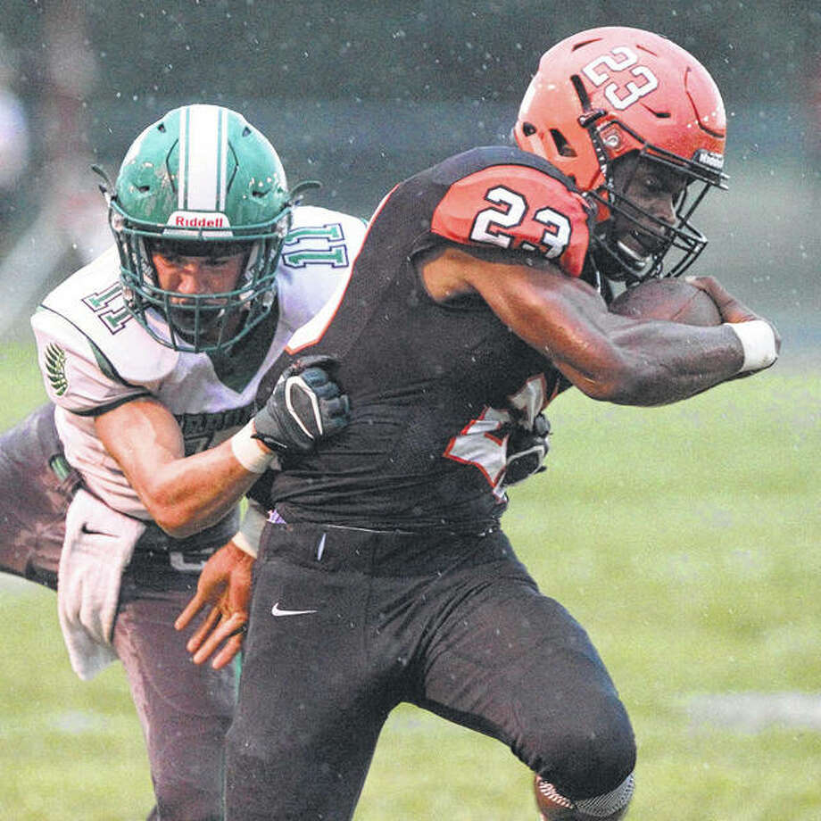 Beardstown's Pascal Guilavogui tries to break away from a Carrollton defender during the first half of a high school football game in Beardstown Friday night. Photo: Dennis Mathes | Journal-Courier