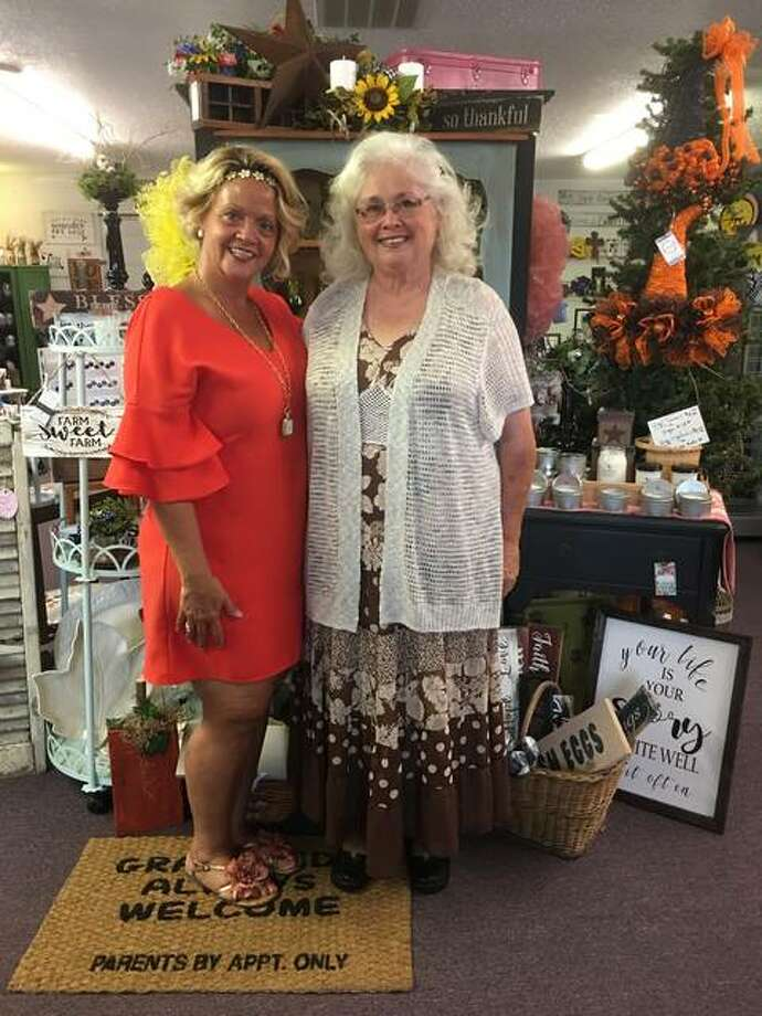 Brighton Pickers Market Executive Director Jerika Burton, of Brighton, who founded The White Door Cottage, 506 S. Maple St., stands in the specialty retail boutique, with Brighton Pickers Market committee co-chair Dolly Hinman, of Summerville, a small community in Chesterfield Township, within the Medora zip code. Hinman is the Chesterfield Township supervisor, a precinct committeewoman for the township and the Worthy Matron of Brighton Eastern Star, who is also a regular vendor of The White Door Cottage. Hinman makes primitive home decor and signs; barn wood items; upcycled decorative bicycles, buckets and baskets; handcrafted baby blankets; crocheted towels; and, more. Her items, among many different kinds of vendors' wares, will be available for sale at the Brighton Pickers Market. Photo: Jill Moon The Telegraph