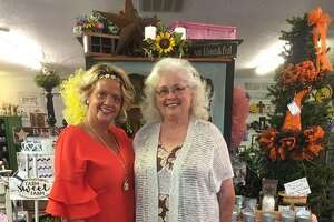 Brighton Pickers Market Executive Director Jerika Burton, of Brighton, who founded The White Door Cottage, 506 S. Maple St., stands in the specialty retail boutique, with Brighton Pickers Market committee co-chair Dolly Hinman, of Summerville, a small community in Chesterfield Township, within the Medora zip code. Hinman is the Chesterfield Township supervisor, a precinct committeewoman for the township and the Worthy Matron of Brighton Eastern Star, who is also a regular vendor of The White Door Cottage. Hinman makes primitive home decor and signs; barn wood items; upcycled decorative bicycles, buckets and baskets; handcrafted baby blankets; crocheted towels; and, more. Her items, among many different kinds of vendors' wares, will be available for sale at the Brighton Pickers Market.